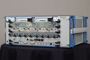 AXIe is a multivendor modular instrument standard. Here, an AXIe chassis is shown with AXIe modules from Cobham (Aeroflex), Guzik, Keysight, plus PXI modules via an adapter.